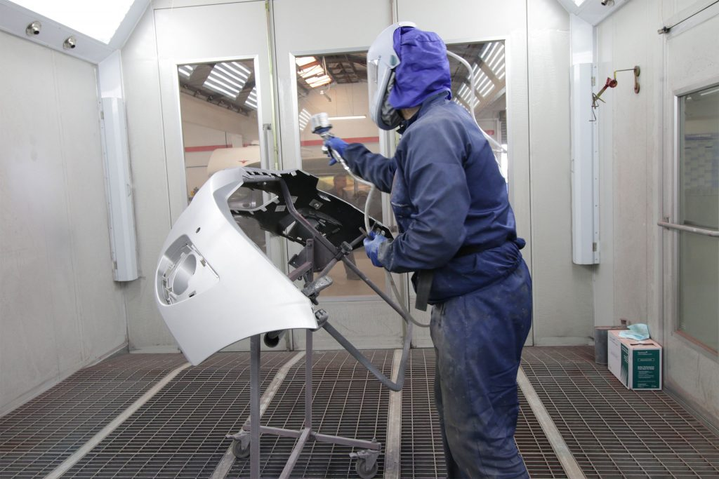 Spraypainting in booth-Precision Panel and Paint
